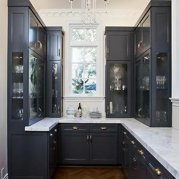 Navy blue kitchen cabinets with overhead glass cabinets for Navy blue kitchen cabinets