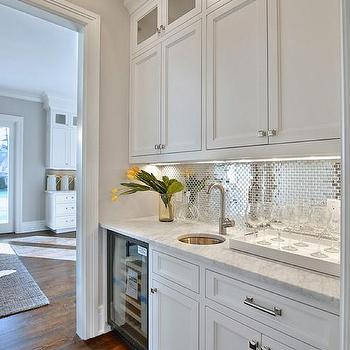white butler pantry with stainless steel mini brick tile backsplash