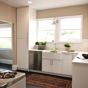 White And Beige Kitchen With Copper Accents