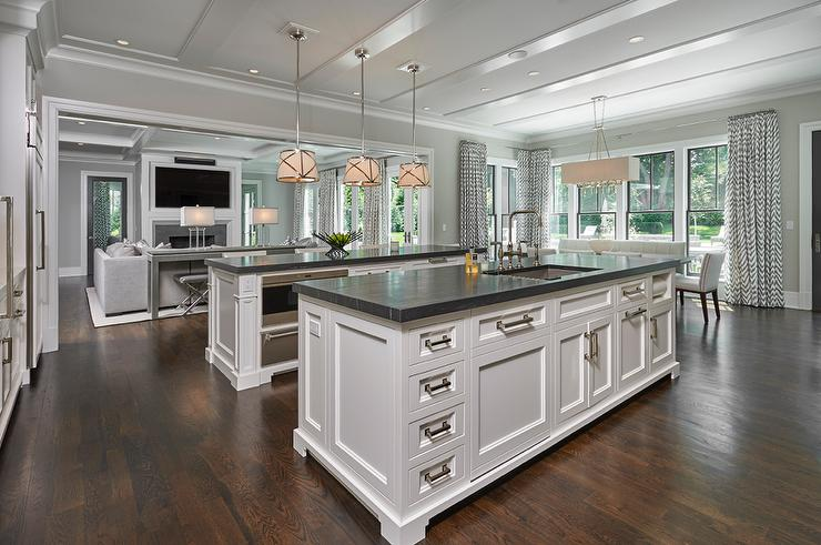 Two KItchen Islands with Black Marble Countertops