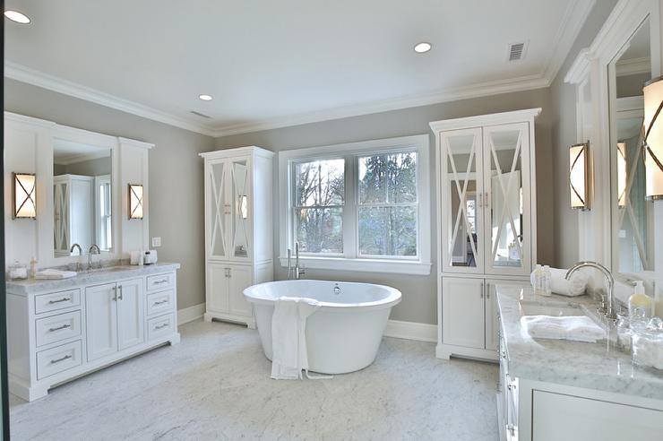 white and gray bathroom with mirrored armoire cabinets