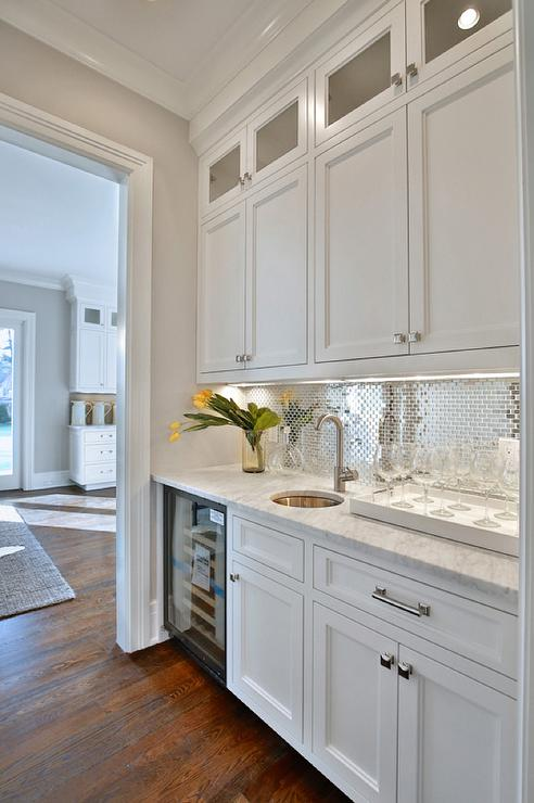 White And Silver Butleru0027s Pantry Features White Shaker Cabinets Paired With  Carrera Marble Countertops Fitted With A Round Bar Sink And A Gooseneck  Faucet ...