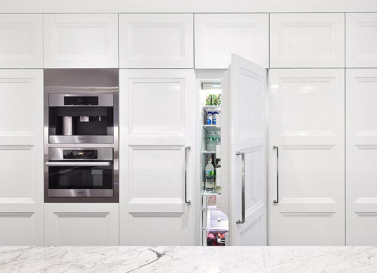 Wall Of KItchen Cabinets With Hidden French Door Refrigerator