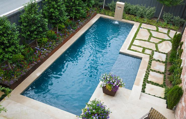 Backyard with inset fountain transitional home exterior for Design pool klein
