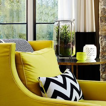 Yellow Wingback Chair With Black And White Chevron Pillow And Throw
