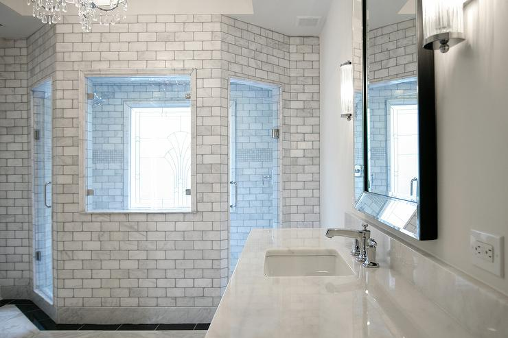 Fabulous Master Bathroom Features A Marble Subway Tiled Shower Fitted With Two Seamless Glass Doors Flanking A Window Overlooking The Bathroom