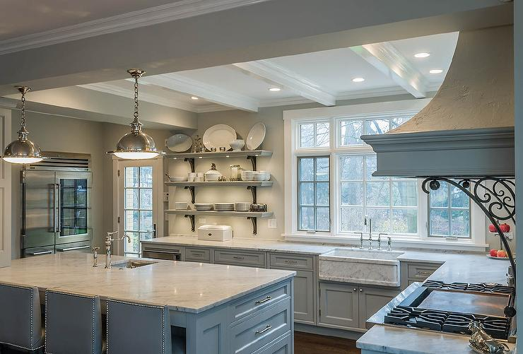 walls painted gray, Benjamin Moore Gray Owl, lined with gray cabinets