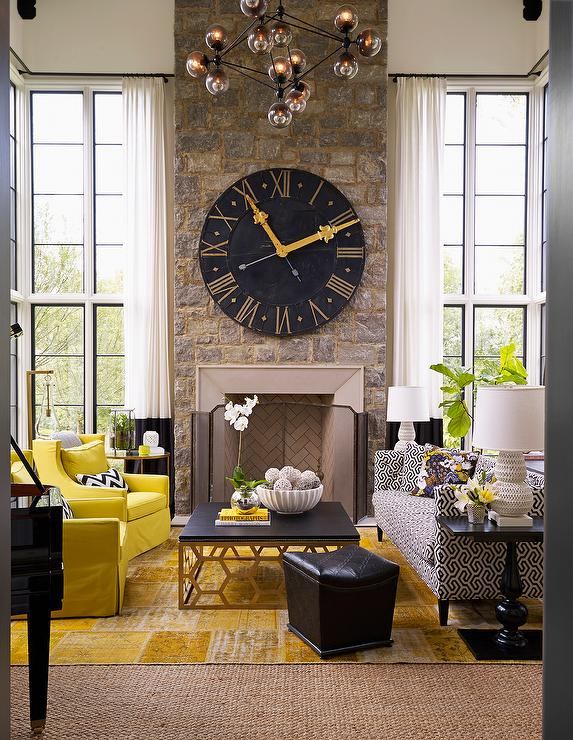 Yellow And Black Living Room With Two Story Ceiling