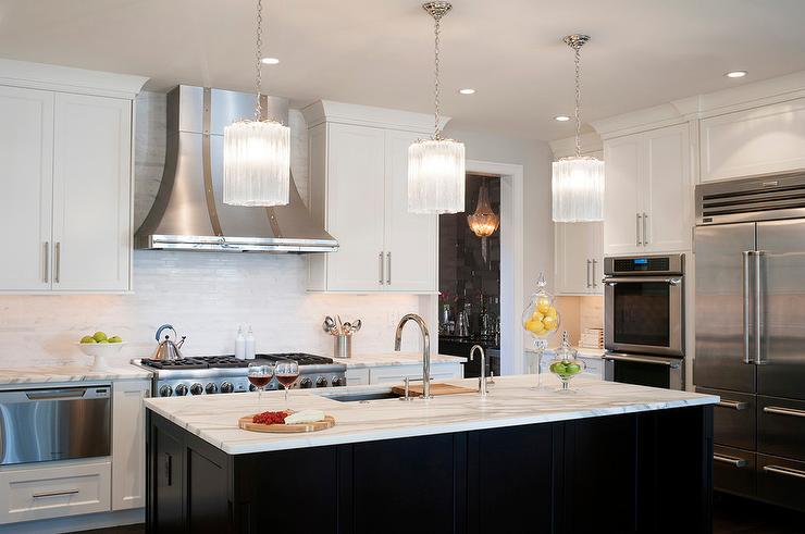 Black Kitchen Island With White Glass Pendants