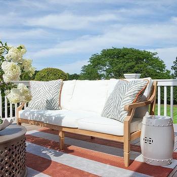 Teak Sofa With Orange Stripe Outdoor Rug