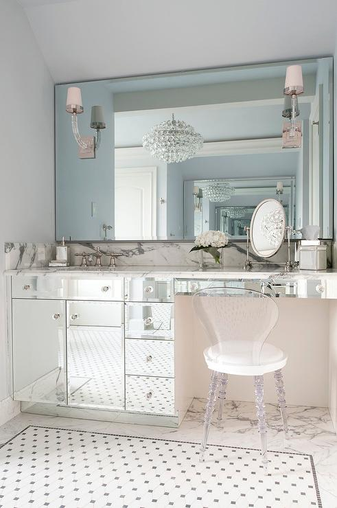 Marvelous ... A Mirrored Washstand Adorned With Glass Knobs Topped With Gray And  White Marble Which Continues Into A Makeup Vanity Paired With A Lucite Vanity  Chair ...