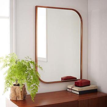 rose gold metal framed wall mirror
