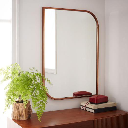 rose gold metal framed wall mirror