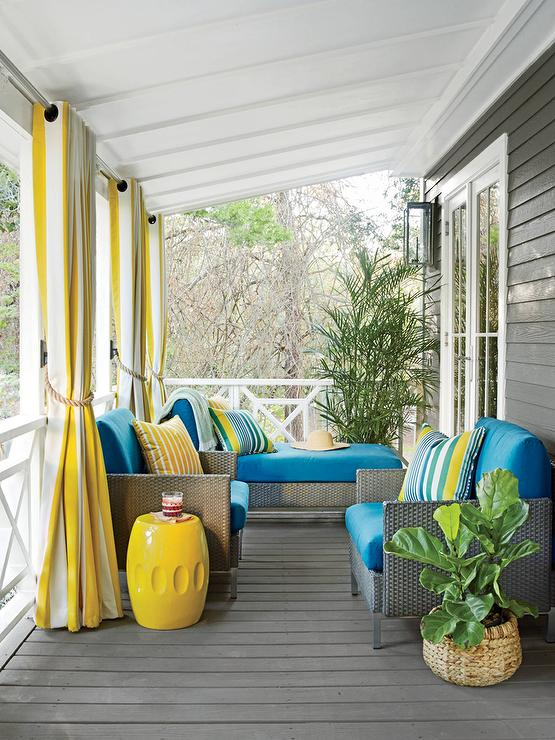 Gray Porch With Yellow Stripe Grommet Curtains