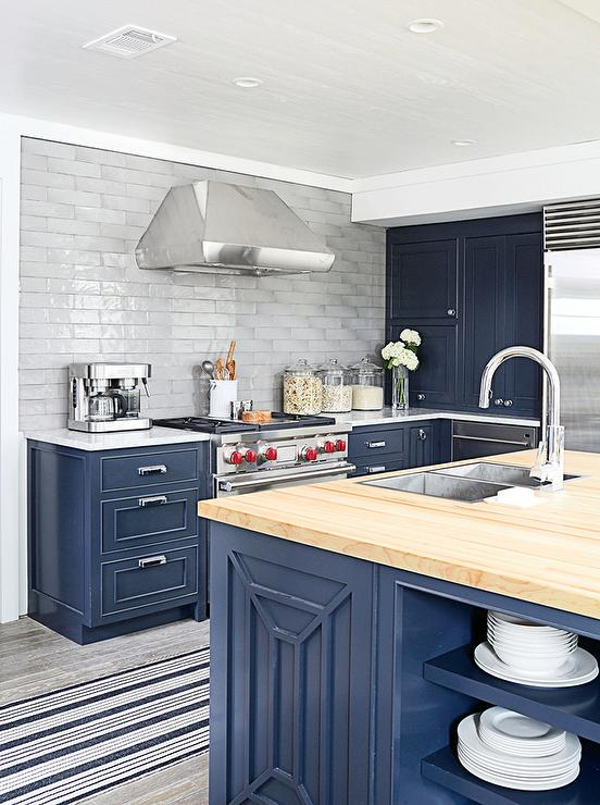 Interior design inspiration photos by coastal living for Dark blue kitchen cabinets