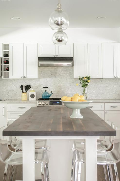 white center island with dark butcher block top