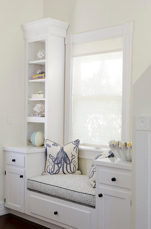 cottage home office with built in window seat and blue