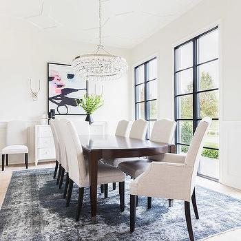 https://cdn.decorpad.com/photos/2016/01/15/m_dining-room-next-to-glass-wine-room-dark-blue-overdyed-rug-camelback-chairs.jpg