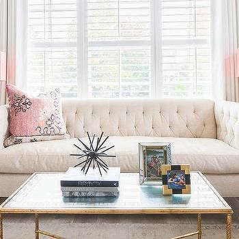 Alyssa Rosenheck: Cream Tufted Sofa With Salmon Pink Lamps
