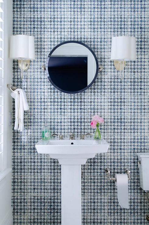Blue bathroom features walls clad in blue mosaic tiles  Pratt Larson Scraffito Tiles Indigo lined with a white pedestal sink and round navy White And Mosaic Design Ideas