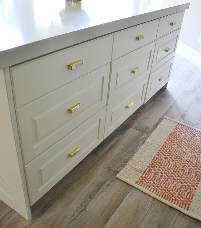 White Kitchen Island Drawers with Brass Pulls - Transitional - Kitchen