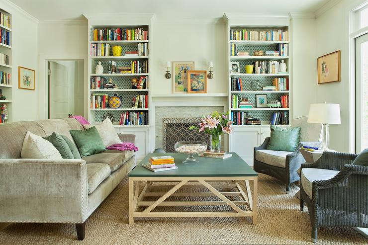 Green And Gray Living Room Features A Velvet Sofa Adorned With Jade Pillows As Well Fuchsia Pom Throw Blanket Facing Pair Of