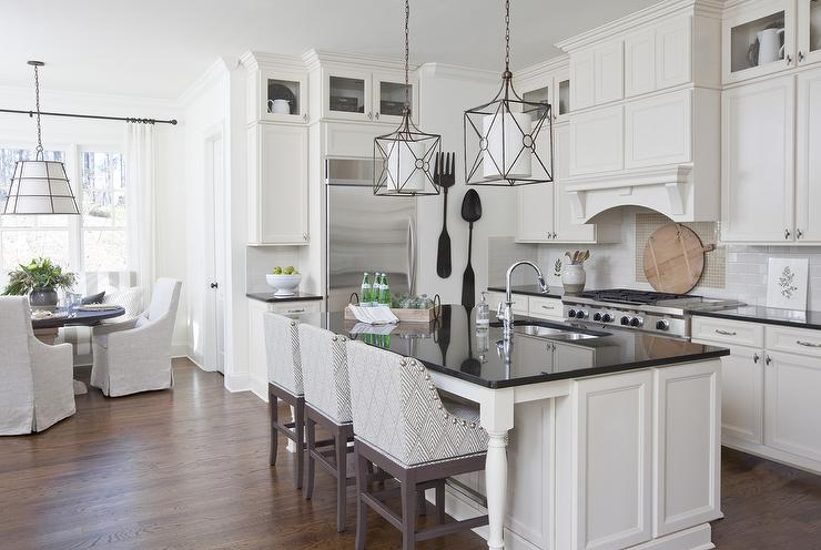 White Kitchen Island With Black Countertop And Gray Curved