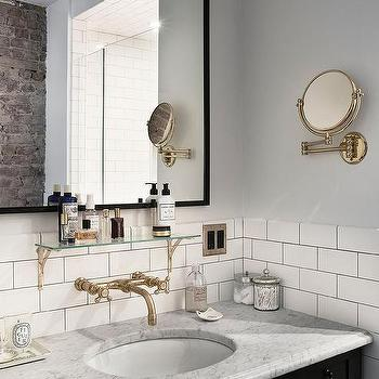 Black Vanity With Carrera Marble Countertop And Vintage Brass And Glass  Shelf