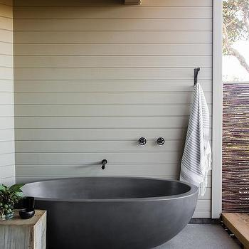Outdoor Bathroom With Gray Tub