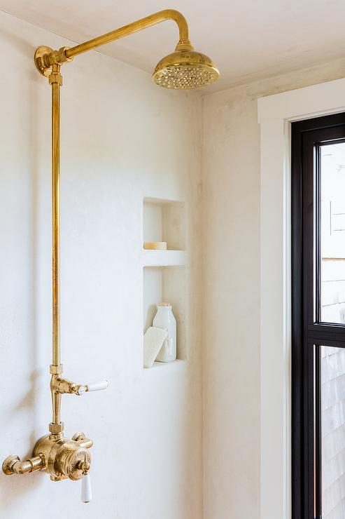 gold rain shower head. Lovely walk in shower is clad stucco lined with a gold vintage exposed  plumbing kit Exposed Plumbing Rain Shower Head Design Ideas