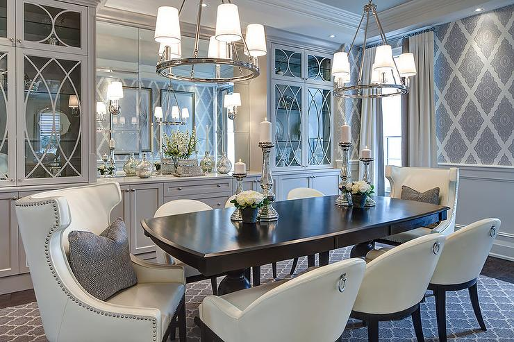 Gray Dining Room Features A Pair Of Ring Chandeliers Cece 5 Light Illuminating An Espresso Table Lined With Ivory Leather Chairs