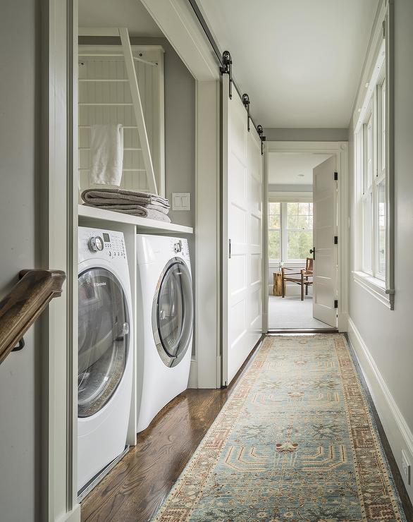 Hallway Laundry Room With Sliding Barn Door On Rails