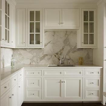 White Shaker Cabinets With Gray And White Marble Slab Backsplash