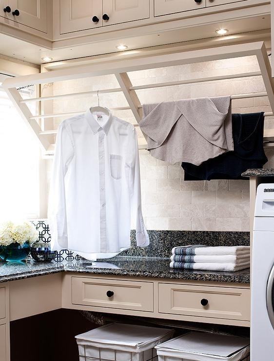 Tan Laundry Room With Drop Down Drying Rack Transitional