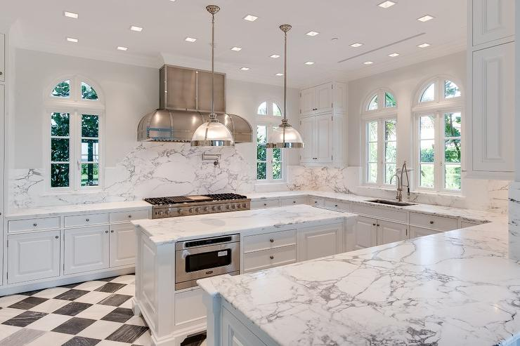 White kitchen with black and white harlequin tile floor for Black floor tiles for kitchen