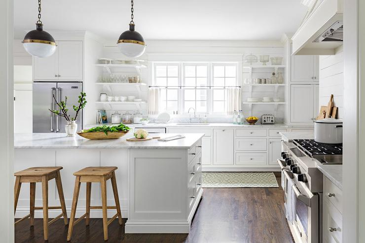 White Country Kitchen Features White Cabinets Paired With White Marble