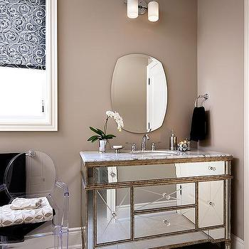 Glam Bathroom With Mirrored Sink Vanity