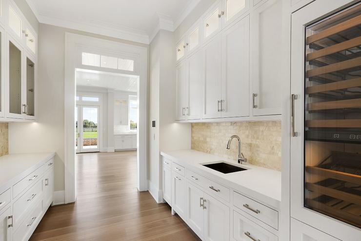 white butler pantry cabinets with gold backsplash