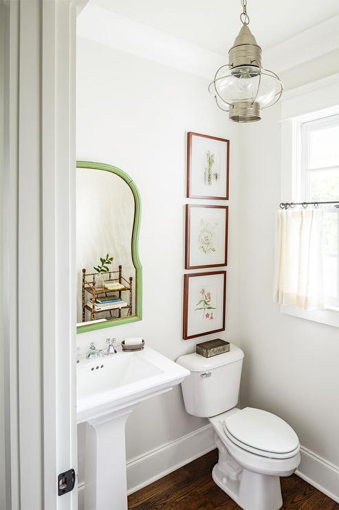 white country powder room with vintage lantern and cafe