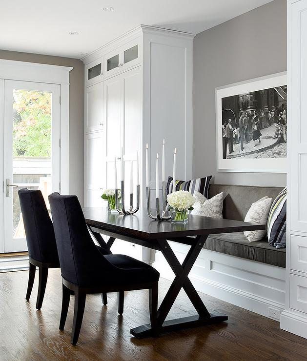 Transitional Dining Nook Features A Gray Built In Bench, Flanked By Floor  To Ceiling Cabinets, Facing A Dark Brown X Based Dining Table Lined With  Navy Blue ...