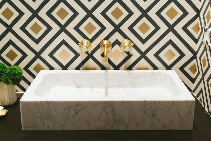 white marble powder room sink with gold faucet