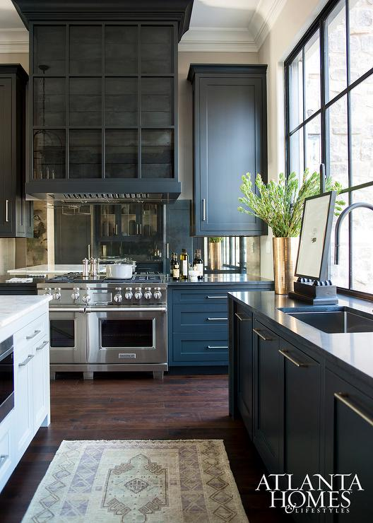 Antiqued mirrored backsplash contemporary kitchen for Dark blue kitchen cabinets
