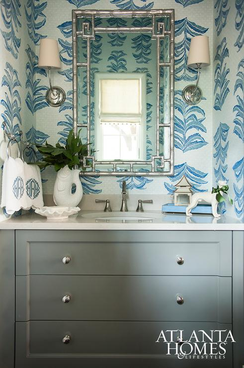 Powder room with blue wallpaper and silver mirror for Blue bathroom wallpaper