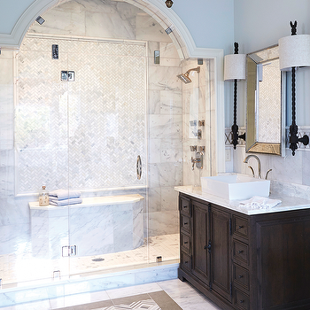 Arched Glass Shower With Herringbone Marble Tiles