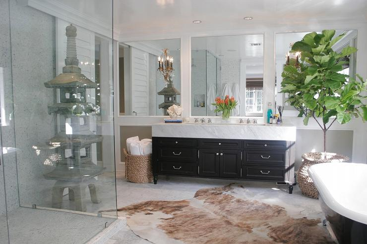 Chinoiserie Bathroom Features A Black Clawfoot Tub Alongside A Brown  Cowhide Rug Layered Atop Gray Floors.