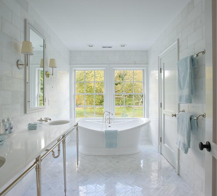White Bathroom with Blue Accents and Marble Herringbone Floors ...