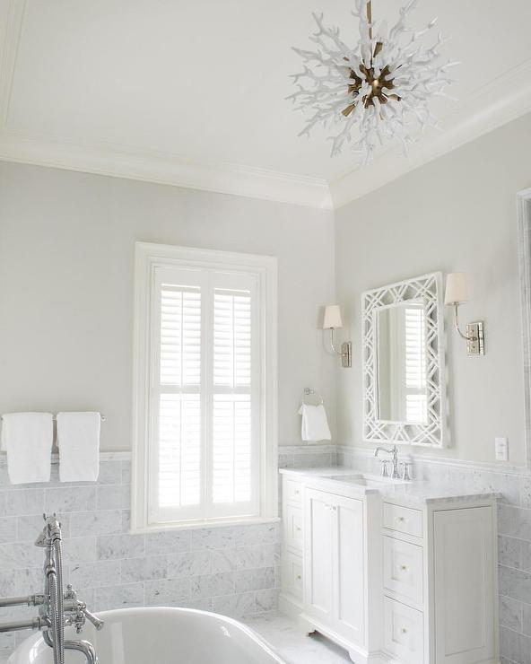 Ethereal bathroom with white bamboo mirror and arteriors for Small chandeliers for bathrooms