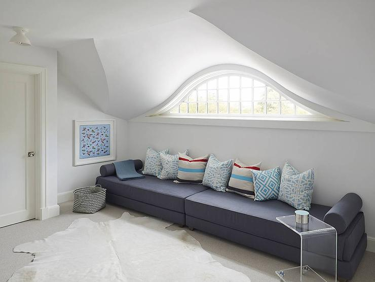 Attic Lounge With Blue Chaise Lounge And Acrylic C Table