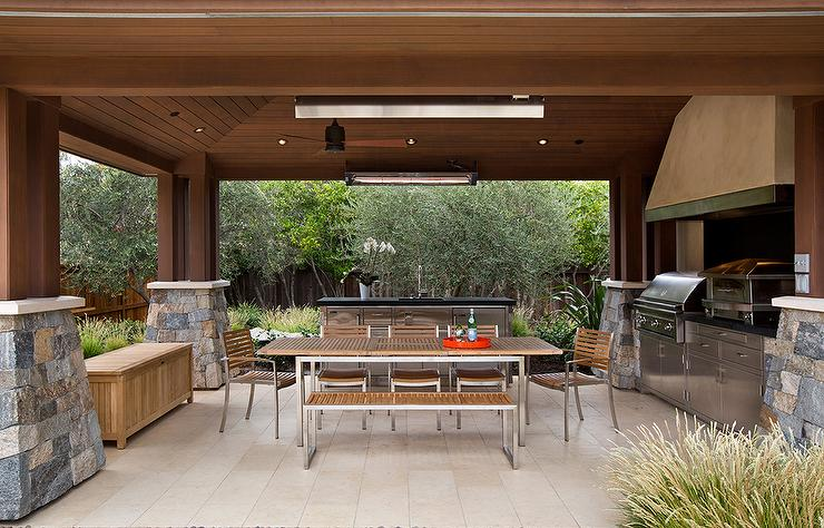Delightful Covered Patio With Teak And Steel Outdoor Dining Table And Chairs