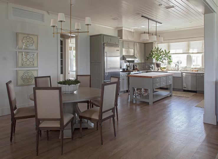 Gray Kitchen Opens To Dining Room